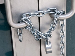 Locked chain on a door 87481768