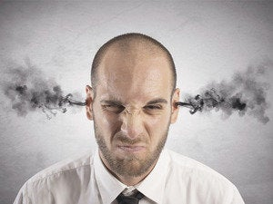Man with steam coming out of ears angry frustrated mad