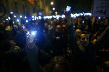 Hungary protesters throw computer parts at government buildings in fight against internet tax