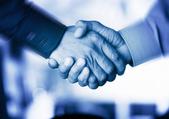 two men shaking hands trust