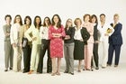 Group of diverse women standing lined up in a row