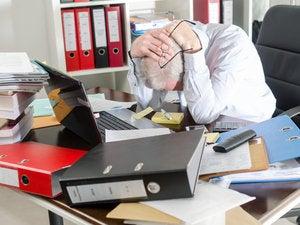 messy cio desk worker office frustration