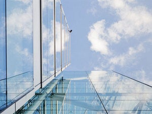 glass building with clouds above