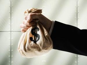 business man holding money bag