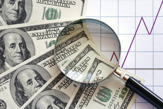hundred dollar bills magnifying glass