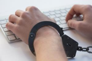 Employee handcuffed to keyboard